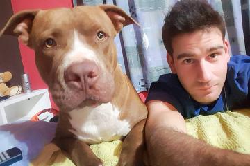 Oscar Dolzani y su perro.jpg